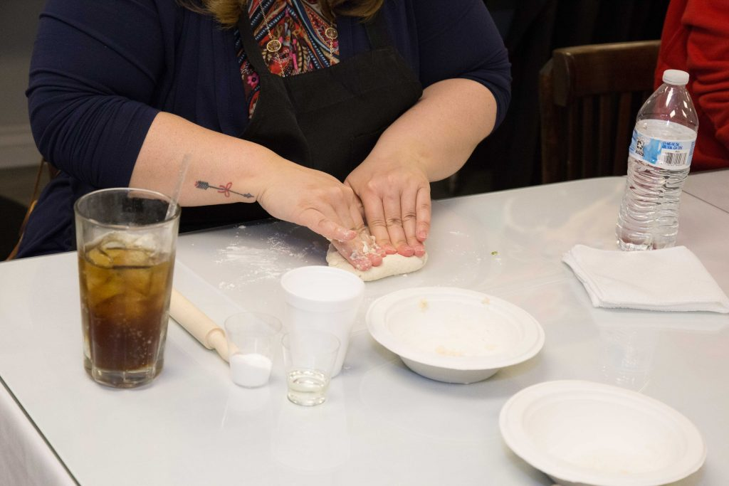 scottsdale cooking class student kneading dough for samosas