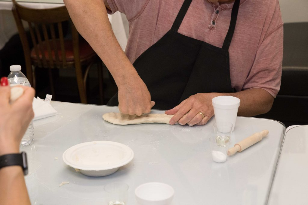 man kneading flour for samosas at Scottsdale Indian cooking class